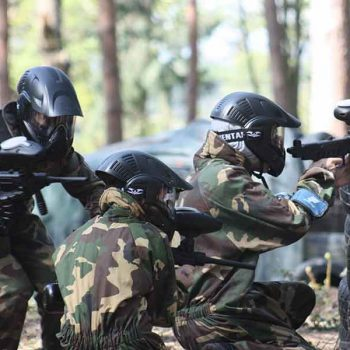 Juniors are playing paintball game