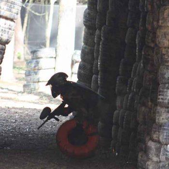 Kid is hidden in paintball game zone