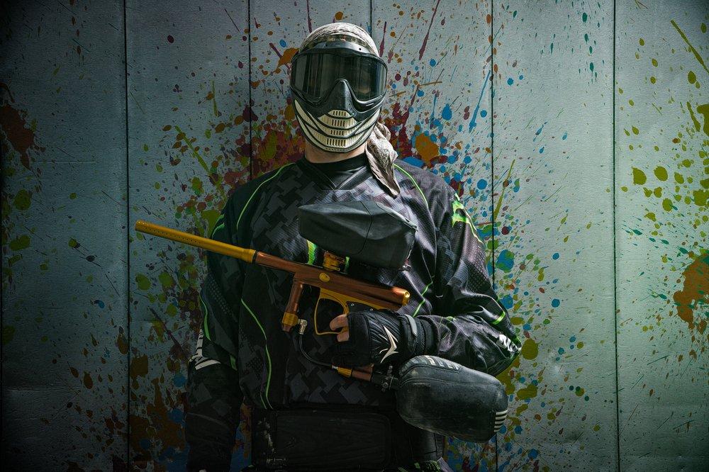 A man With Paintball Gun Standing